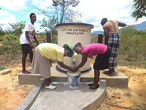 Sponsors of this village's water pump in Africa